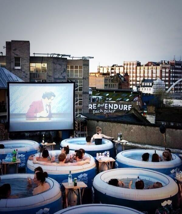 outdoor movie theater...omg I so want to watch a movie from a hot tub. That is a genius idea!