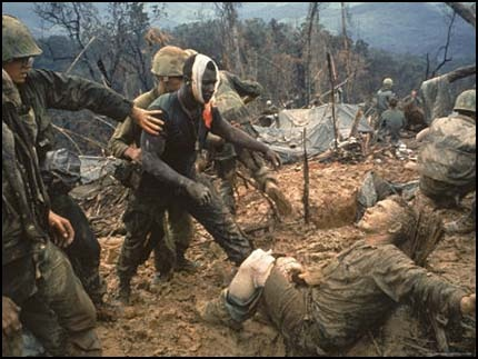 Larry Burrows picture from Vietnam war.I found this on a blog and underneath it was post written by the daughter of the white wounded soldier in the picture. It read 'The soldier sitting on the ground, wounded and exhausted, is my father. He was PVT David Schaefer at the time, now retired SFC David Schaefer. He was 19 years old in the photo. The black man in the photo saved my dad's life. I can't write too much, as this photo evokes emotions I surpress when seeing this.