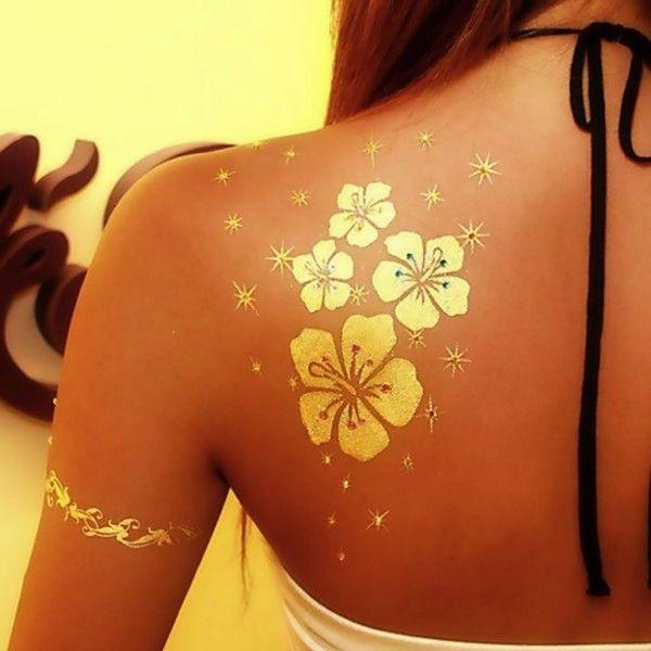Golden flowers tattoo - ohhhh......so pretty!