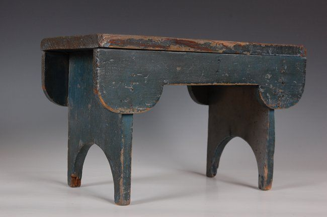 CRICKET STOOL Slate blue surface, scalloped cutout base and apron, square nailed. Pennsylvania Sold $275
