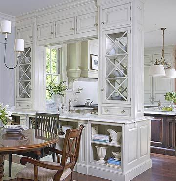 I like the idea of a slight separation between the eating and cooking spaces, yet keeping them connected enough for everyday convenience