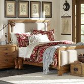 Constructed from sturdy and durable hardwood with acacia veneers, the Delaney bed set boasts an upholstered center panel with antiqued-brass nailheads, and is finished in a light driftwood tone for a polished yet informal look. Available in queen and king sizes.