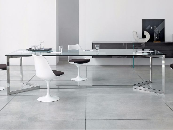 Gallotti&Radice Carlomagno table  Table with transparent extralight top with 15 mm thickness. Structure in polished stainless steel with profile 40x20x2mm. Available on demand also with painted glass top and structure in satin stainless steel or embossed white or black lacquered steel.  http://www.industryinterior.com/en/prod/living-room/table/gallotti-radice-carlomagno-table.html