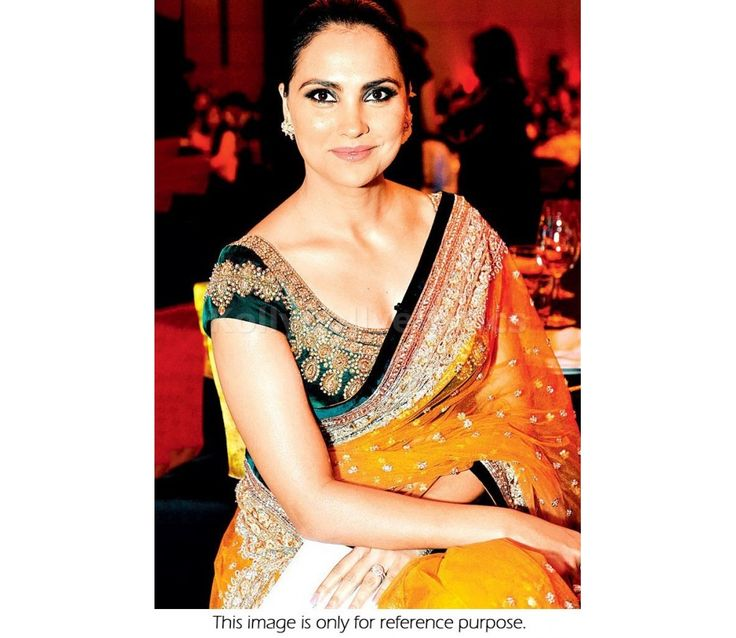 Buy Bollywood Replica Lara Dutta Net Saree in Orange and Green color in UK, USA, Canada, Mauritius and Fiji through online shopping. This saree comes with the worldwide free shipping offer.
