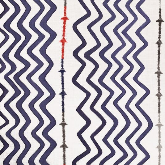Rick Rack Fabric A fun graphic fabric designed by Kit Kemp, with large scale painterly zigzags printed in indigo, interspersed with a thin band of arrows embroidered in various shades including, red, green and neutral.