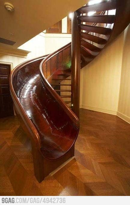 Staircase Design - This spiral staircase idea and design comes equipped with a slide.