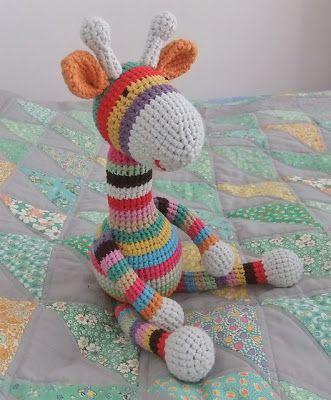 A wonderful way to use up scrap yarn. ♥  Visit I Love Button's and make a stripy giraffe.