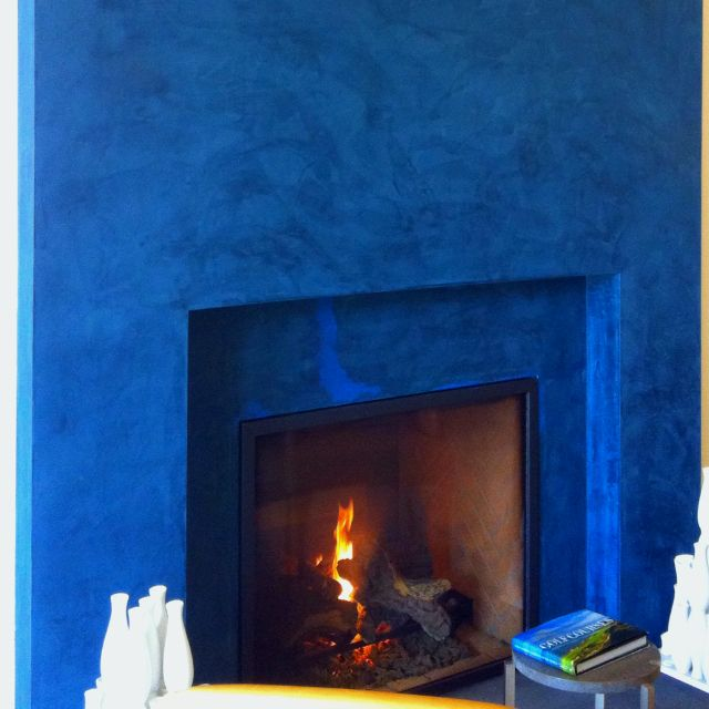 Indigo blue wall behind bed. Use same paint to redo bookshelf.