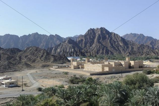 Oasis and Arab enclave of Hatta with palm trees with the Hajar Mountains on the horizon United Arab Emirates Arabian Peninsula Middle East Asia