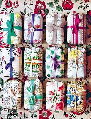 guest soaps wrapped like a present in vintage papers. so beautiful!