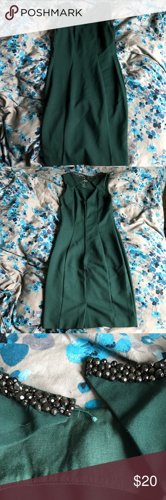 H&M dark green bodycon dress with jeweled collar Dark green dress with details around the collar from h&m. Size 4. Worn once and washed. The only flaw is that the band for the top button broke off on one end (see 3rd picture), but it should be an easy fix. Back zipper is in excellent condition. H&M Dresses Mini