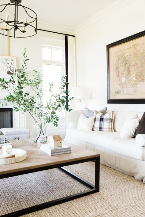 We can't help but think about fall decor with this new Mountainside Remodel from Studio McGee | neutral living room with black accents