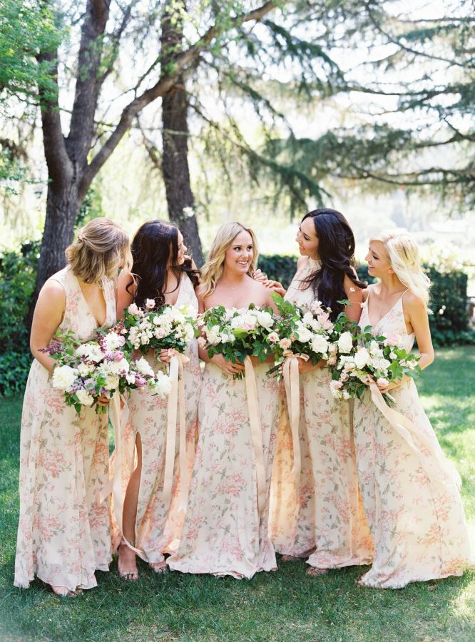 Trendy floral bridesmaid dresses: http://www.stylemepretty.com/2016/01/13/spring-napa-valley-wedding-with-floral-print-bridesmaids/ | Photography: Jessica Burke - http://jessicaburke.com/
