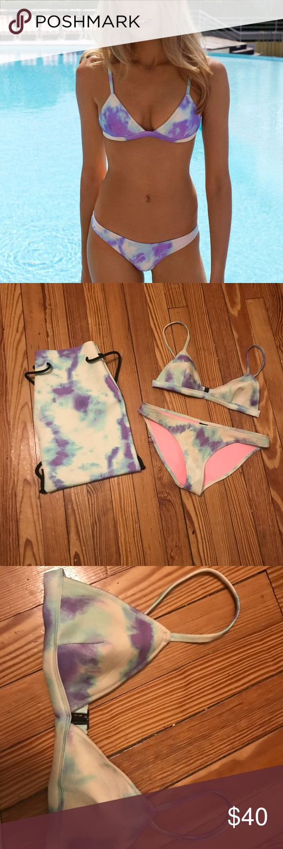Triangl Bikini tie dye Triangl bikini Tie dye pattern - light purple and blue with white Bottom bikini cut - size large (fits a 6/8 bottom) Top - size small + (fits small c Cup) Comes with matching backpack 100% neoprene  Good condition triangl swimwear Swim Bikinis