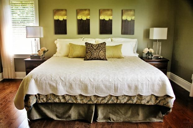 Instead of a headboard, put four smaller pieces of artwork across the bed (king size). Not liking the colors, but loving the idea!