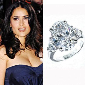 Salma Hayek wears a five-carat oval cut diamond with trillions on each side from her husband Francois-Henri Pinault. The ring is set in platinum and estimated to cost around $200,000.Read about Salma Hayek's Italian weddingPhoto: Flynet Pictures