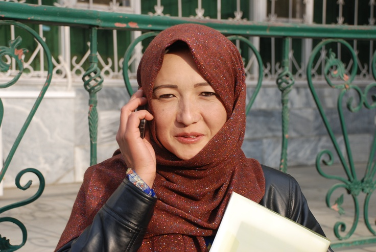 A woman speaks on the phone in Afghanistan.