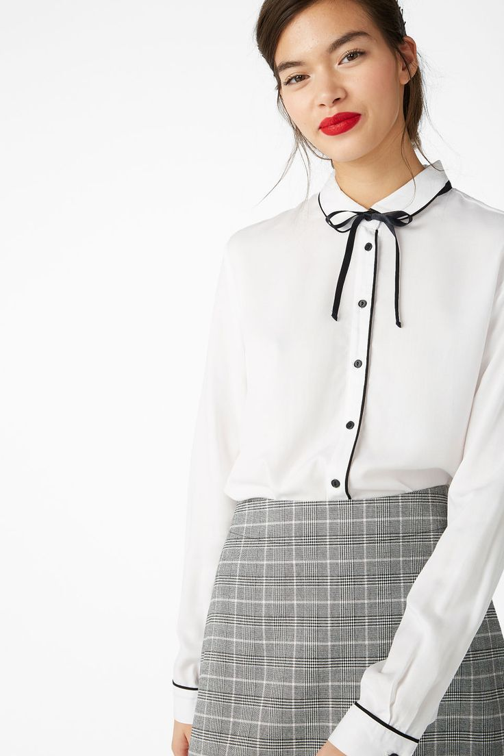£20 Monki-A long sleeved classic white blouse with black details. Tie a bow and you're good to go!</p><p>In a size small the chest width is 101 cm.</p><P>The model