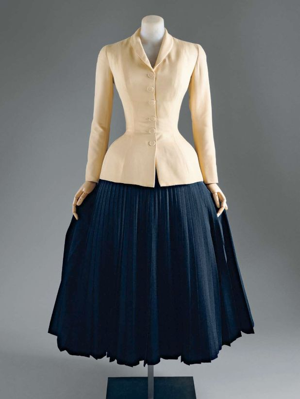 "Christian Dior, 1947. A typical ""New Look"" silhouette with rounded shoulders, a nipped-in waist, and a full, long skirt."