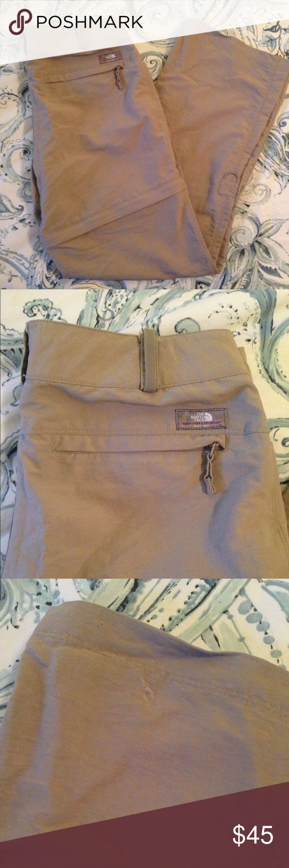 "North Face Tan ZipAway Convertible Pants Short 12 The North Face women's convertible hiking outdoor pants. Size 12.   Legs unzip to shorts or legs can be rolled up and buttoned to capris.  Inseam 31.25"" Shorts inseam 6"" Leg opening 9.5"" Waist laying flat 17.5""  100% nylon The North Face Pants Track Pants & Joggers"