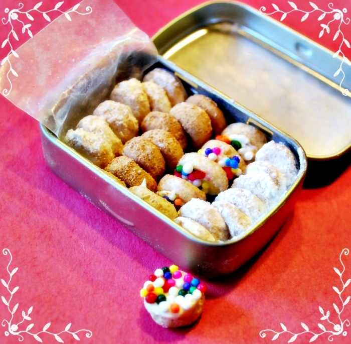Jack and I made these tiny elf donuts out of Cheerios! We used a tiny Altoids box to store them.