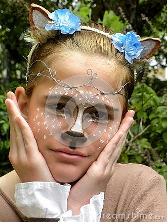 A view of a young girl dressed up as a happy fawn for Halloween.
