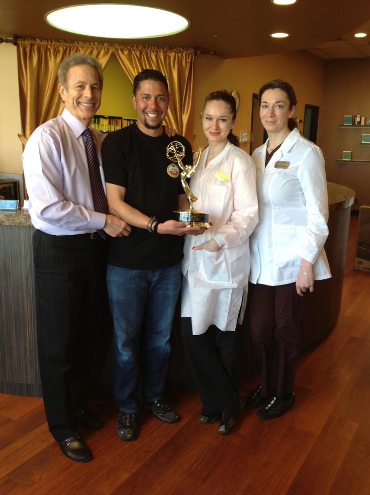 Dental 2000 Patient Carlos Gonzalez (center) took home the Sports Emmy Award for his Outstanding Technician Crew featured on the MLB tonight show. Standing with Carlos (from left to right) is Dr. Larry Kaplan, Hygienist Olivia and Dr. Glants. Congratulations Carlos on a job well done! Team Dental 2000 is so proud of your accomplishment! #dental2000nj