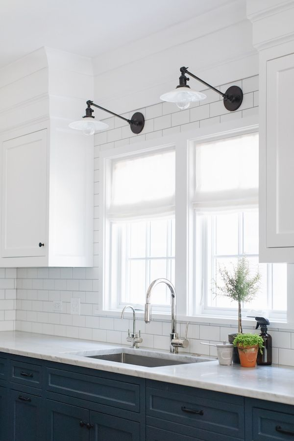 Hogan Kelly Design Task Wall Lights Over Kitchen Sink Blue And White Cabinets White Subway Tile Backspl Kitchen Wall Lights Kitchen Wall White Subway Tiles
