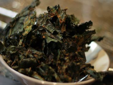 Roasted Kale Chips ~  Wash and dry kale.  De-stem. Lightly dress with olive oil and a sprinkling of sea salt.  Spread leaves on drying rack on baking sheet.  Bake @ 300F for 30 mins.; turn w/tongs if necessary. Cool completely; store in ziplock bag.