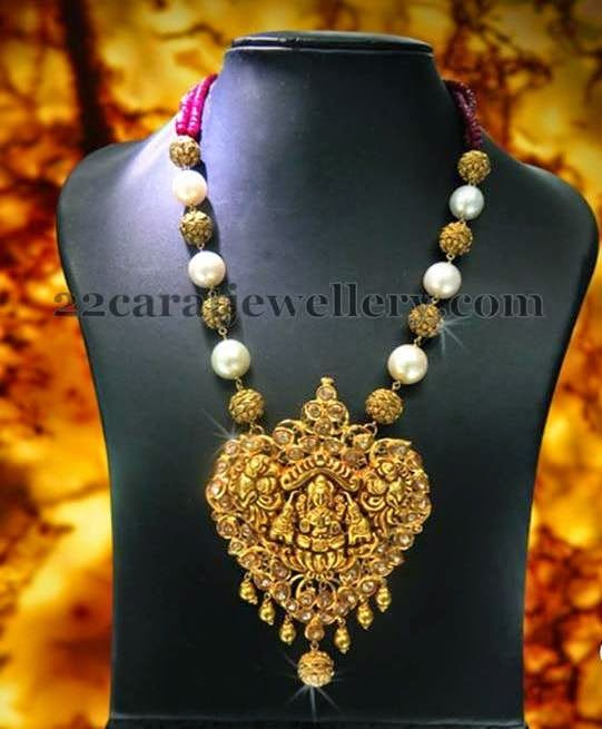 Jewellery Designs: Antique Lakshmi Pendant with Pearls Chain