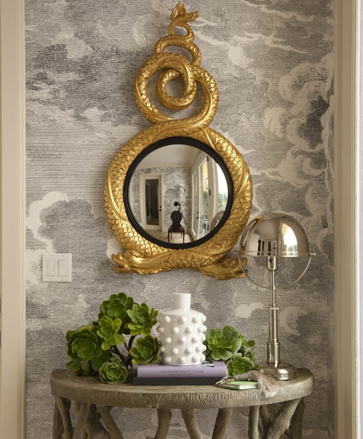 grisaille wallpaper with a Regency giltwood mirror and twig console
