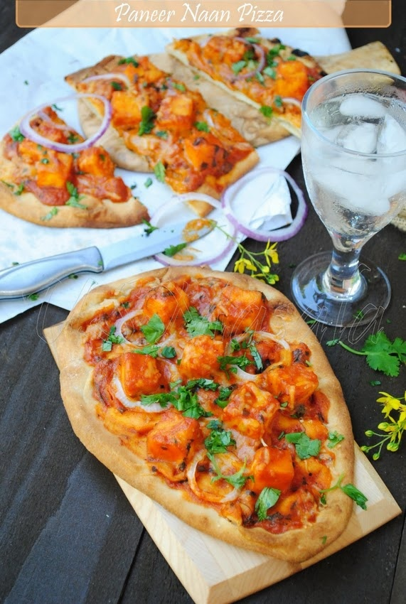Paneer & chicken tikka masala on naan- indian pizza. Oh my.