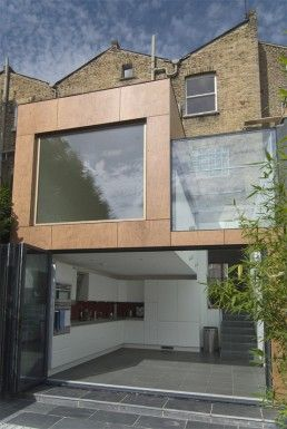 Crawford Partnership, a London based architecture firm, is responsible for adding modern extension to home in busy part of the city close to Camden Town