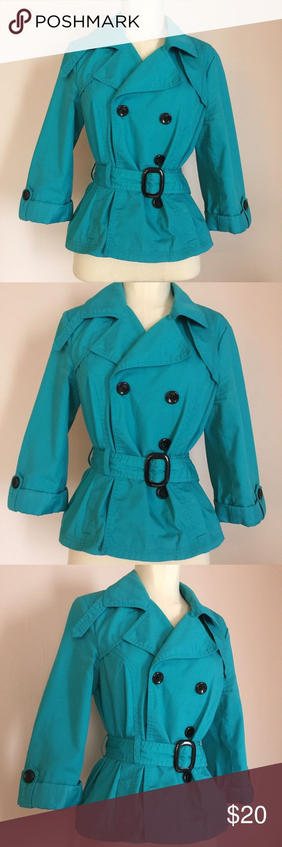 """H&M Teal Blue Short Trench Coat Summer Style 8 M Bright blue lightweight trench coat by H&M. This adorable jacket is like new, having only been worn once. Even comes with extra buttons! Made of polyester and has a bright plaid lining. A must for those cold Summer nights! Tagged a size 8, and would work for a size small or medium. Measures 38"""" from underarm to underarm, 36"""" at waist, and length is 22"""" from shoulder to hem. H&M Jackets & Coats Trench Coats"""