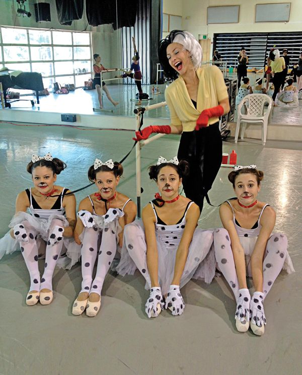 Samantha Galler as Crella de Vil with dalmatians (from left) Jennifer Lauren, Ashley Knox, Leigh-Ann Esty and Nicole Stalker (photo courtesy Leigh-Ann Esty)