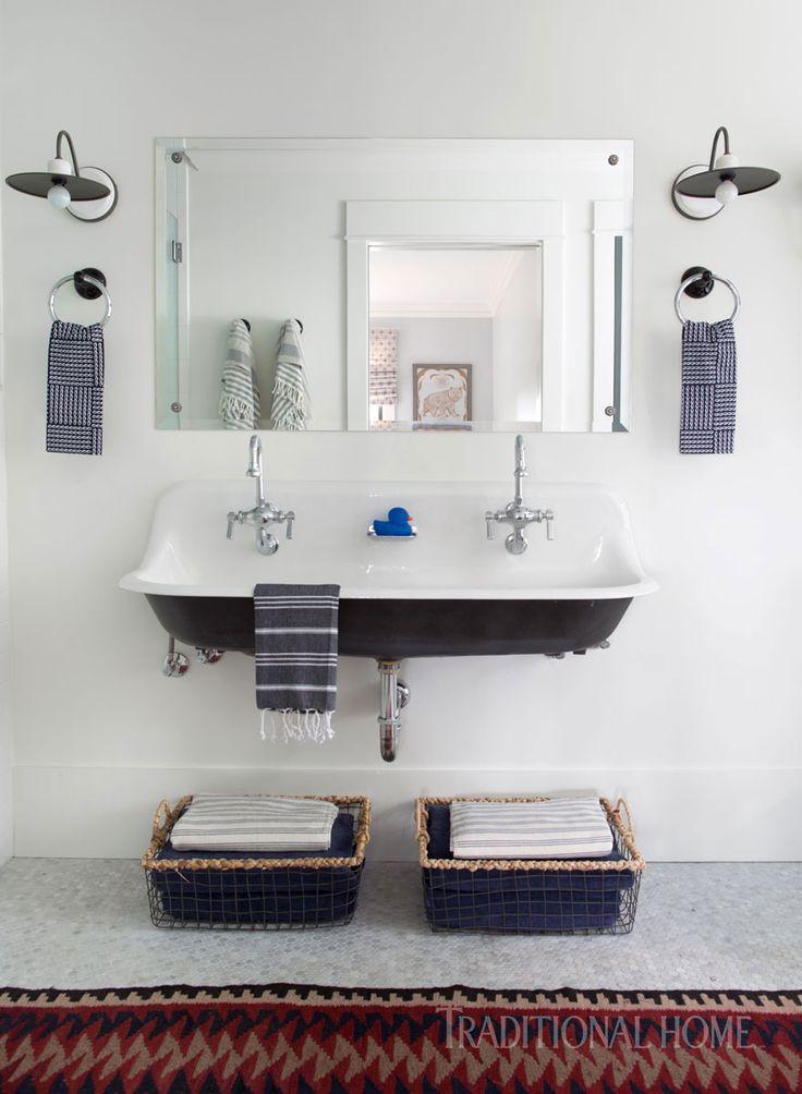 A trough sink by Kohler evokes the farmhouse spirit. Rustic sconces are from Currey & Company. - Photo: Sarah Dorio / Design: Cloth & Kind