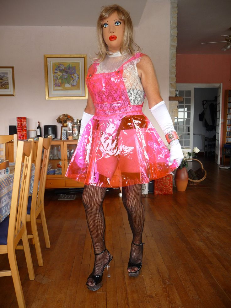 "Pink plastic dress ""hiding"" the female chastity belt:-)"