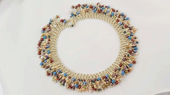 Necklace is made of silver beads and Swarovski pearls Toho . Very effective