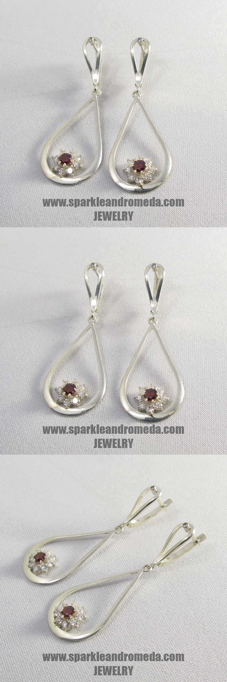 Sterling 925 silver earrings with 2 round 4 mm red almandine color and 16 round 3 mm and 2 round 2 mm white color cubic zirconia gemstones.