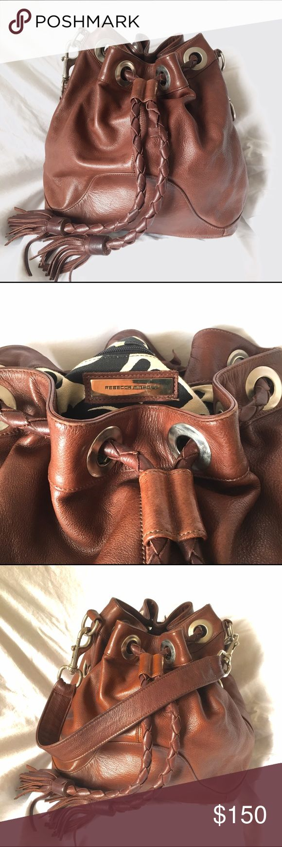 Rebecca Minkoff Bucket Bag Beautiful brown leather bucket bag with black and white fabric interior. Shoulder strap, 1 zip pocket, and 2 cell phone pockets inside. Slight wear but overall good condition. Rebecca Minkoff Bags Shoulder Bags