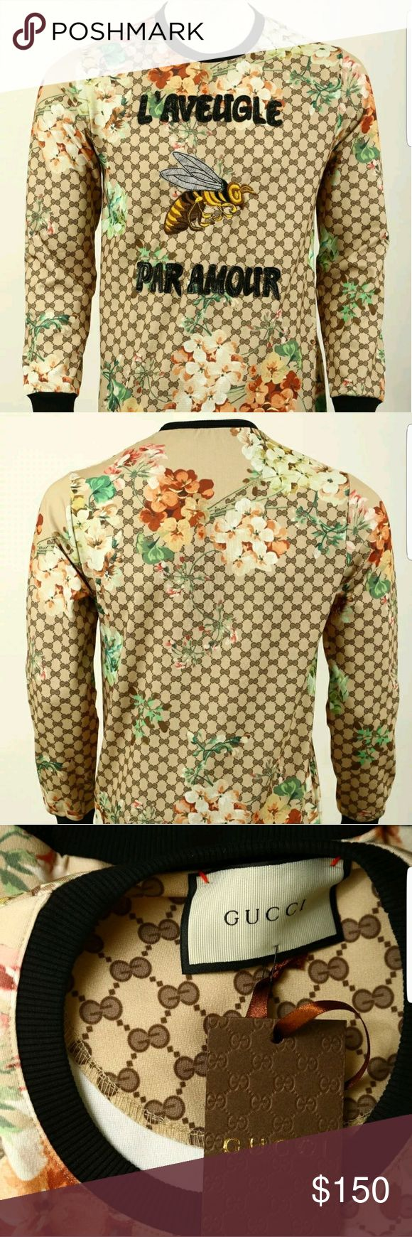 GUCCI SWEATER This sweater has the gucci logo all over so everyone will know you have on GUCCI. Its very lightweight so perfect with a pair of designer jeans Gucci Sweaters Crewneck