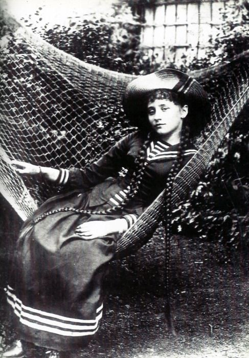 French author Colette, late 1800s  Amazing braids and sailor dress!