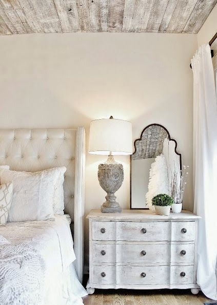 A beautiful neutral colored french country bedroom idea from Kathy Kuo. The whitewashed planked ceiling adds a rustic chic decor topic to this space