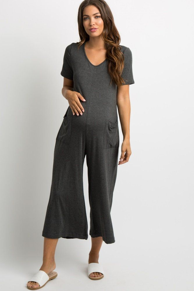 378926e1b9ba Charcoal Grey Cutout Back Pocketed Jumpsuit A solid hued maternity jumpsuit  featuring a cropped wide-leg style, two front pockets, short sleeves, ...
