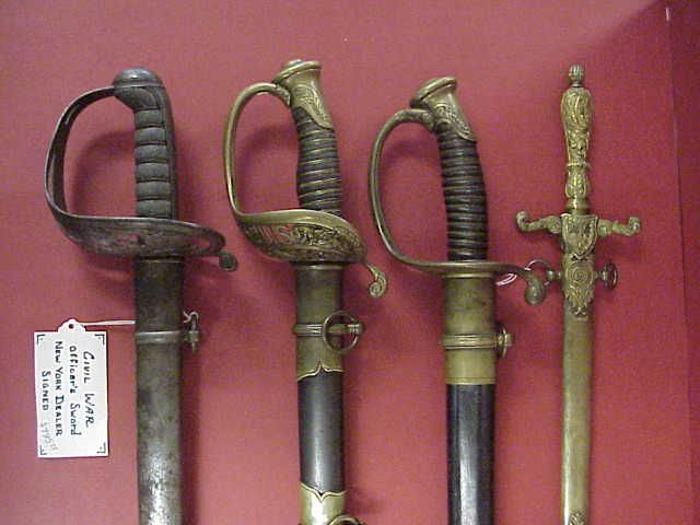 4 Union Officer's swords including: Non-Regulation officer's sword Model 1850 Staff & Field Sword , Model 1850 Foot Officer's Sword Medical Staff (Surgeon's) sword