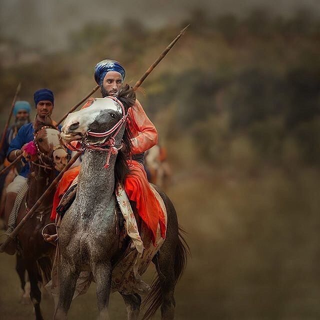 """Nihang"" is the Persian word for Crocodile that the invading Mughals would give to Akalis because of their ferocious fighting styles. Nihangs were also of high regards amongst fellow Sikhs. 'boohaa khol(h) de nisang aae nee nihang.' Open the door do not be afraid a Nihang has come your house. -amazing capture by Amardeep Singh (amardeepphotography.com)"