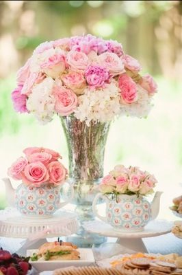 Roses in tea pots centrepieces ... too cute for words
