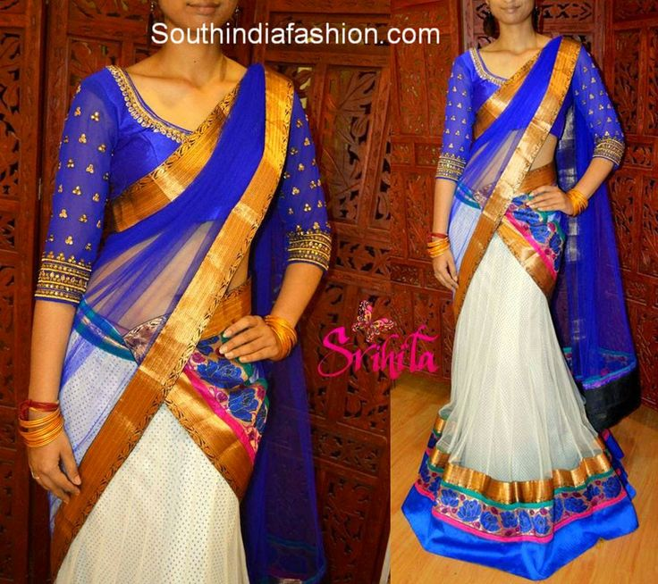 White lehenga with gold, pythani and blue borders and blue net duppatta with gold border by Srihita Exports. Price: Rs. 7,900