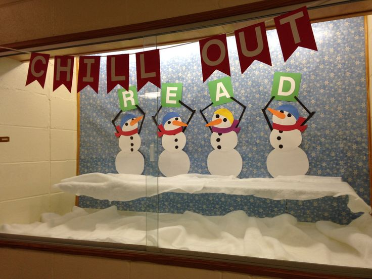 """Winter library bulletin board.  Chill Out  sign hangs outside the display case.  Snowmen hold up the letters which spell """"READ"""".  Wrapping paper background, quilt batting snow."""
