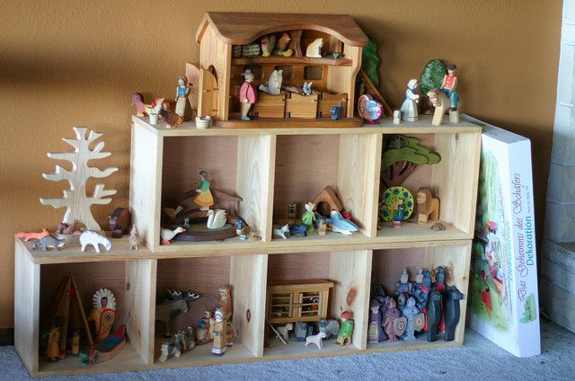 Using shelves to create a large small world play unit. Really lovely idea!